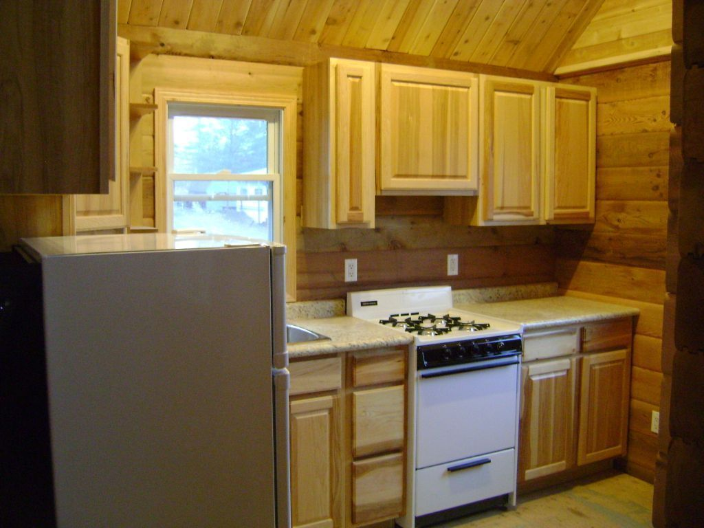 Log cabins emerald lake camp for Cedar kitchen cabinets